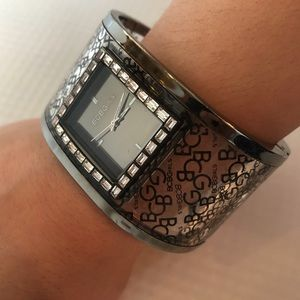 BCBG lady's bracelet snap-on watch with gems